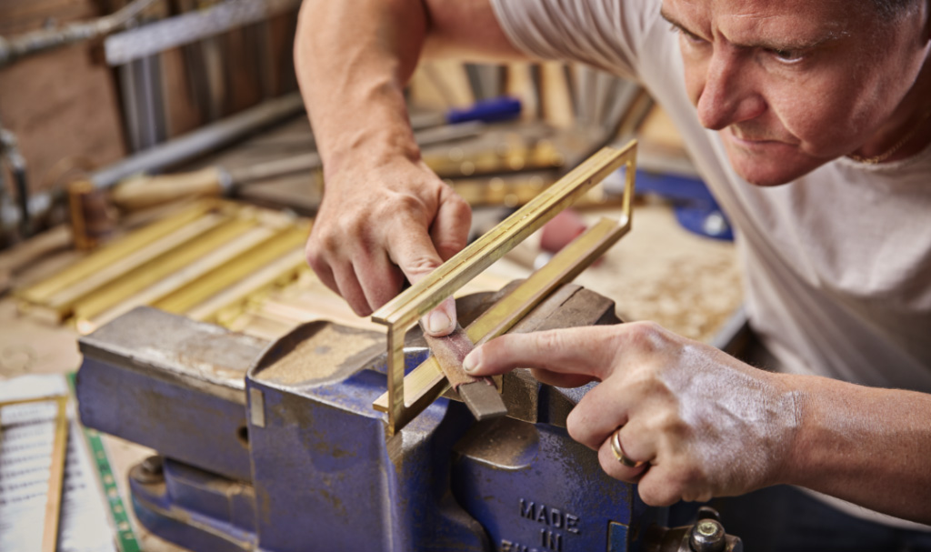 man working with bespke metalwork